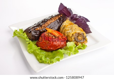 Stuffed vegetables on the plate on isolated white background