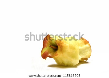 Stump of an apple isolated on white - stock photo