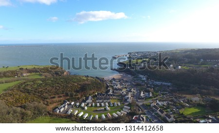 Stunning aerial picture overlooking Dunmore East, Ireland. Dunmore East is a popular tourist and fishing village in County Waterford, Ireland. Situated on the west side of Waterford Harbour.