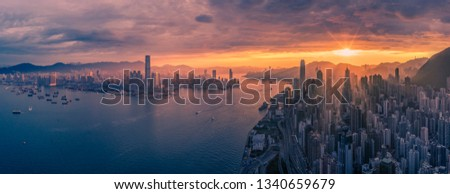 Stunning aerial view at Hong Kong Central district and Victoria Harbour at the dawn, made with drone.  #1340659679