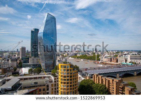 Stunning aerial view of the river Thames in London with Blackfriars bridge and a futuristic looking skyscraper in the shape of a vase. Cityscape of London Southwark.