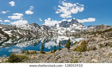 Stunning Alpine Lake Scenery. Banner Peak towering above Garnet Lake in the Ansel Adams Wilderness, Sierra Nevada, California, USA.