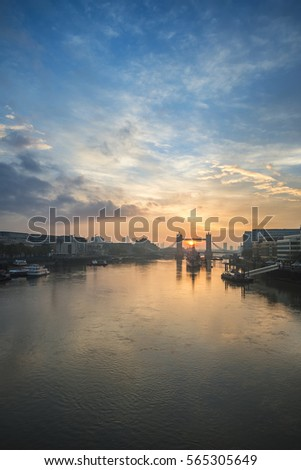 Stunning Autumn sunrise over River Thames and Tower Bridge in London #565305649