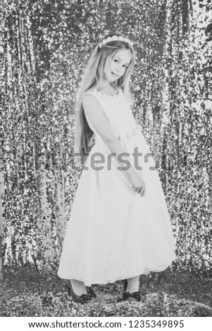 Stunning beauty young girl model in the white communion dress stands in an elegant pose. #1235349895