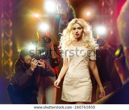 Stunning blonde beauty and press photographers