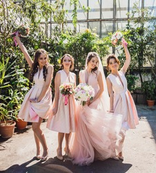 Stunning bride and bridesmaids pose outside