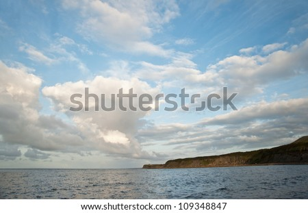 Stunning cloud formations at sunrise over ocean