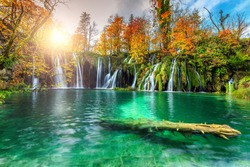 Stunning colorful autumn landscape with spectacular lake and waterfalls in Plitvice lakes National Park, Croatia, Europe