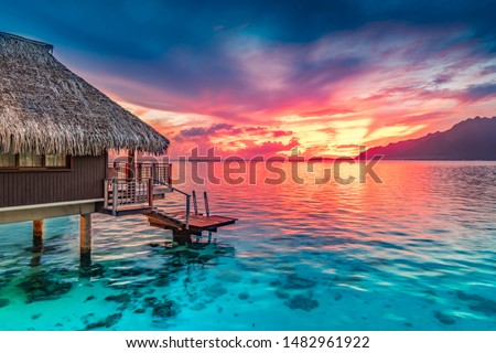 Stunning colorful sunset sky on the horizon of Moorea, the South Pacific Ocean.
