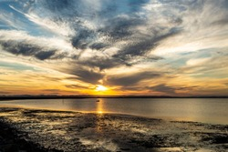 Stunning colours of a sunset behind the town of Deception Bay, Queensland, Australia
