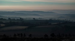 Stunning foggy and frosty sunrise landscape at Haddon Hill, Exmoor national park, Devon, UK