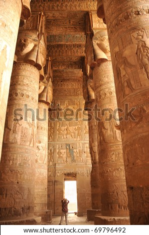 Stunning gigantic carved and painted Hathor columns in the ancient Egyptian fertility and love temple of the goddess Hathor at Dendera, in Egypt