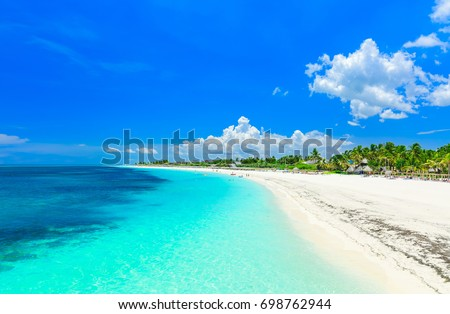 Shutterstock stunning gorgeous, amazing view of a tropical white sand beach and tranquil turquoise ocean at Cayo Coco island, Cuba on sunny beautiful summer day