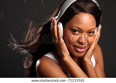 Stunning happy black woman wearing headphones