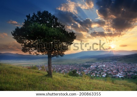 stunning HDR sunset over the small valley with village in bulgarian Rodope mountain