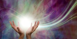 Stunning Healing Energy phenomenon  - female hands reaching up into a ball of white  energy with a laser trail and pink green ethereal energy field  background