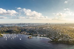Stunning high angle aerial drone view of Balmoral Beach and Edwards Beach in the suburb of Mosman, Sydney, New South Wales, Australia. CBD, North Sydney and Chatswood in the background left to right.