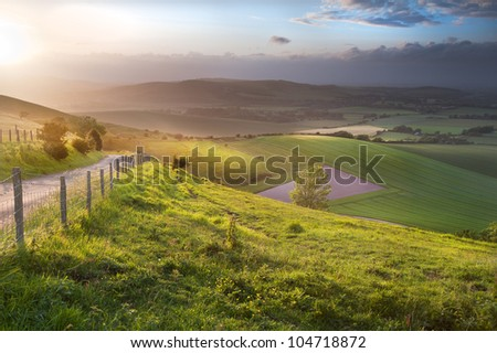 Stock Photo Stunning landscape at sunset over rolling English countryside