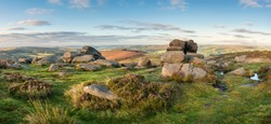 Stunning landscape view of late Summer heather in Peak District around Higger Tor at sunrise