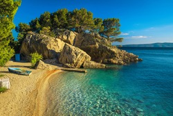 Stunning landscape with clean sea and pine trees on the cliffs. One of the best visited beach in Dalmatia, Brela, Makarska riviera, Croatia, Europe