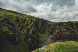 Stunning landscapes of Iceland. Mountains, cliffs overgrown with moss. Beautiful and untouched nature.