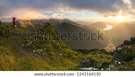 Stunning late afternoon winter light on top of Great Gable, in the Lake District looking towards Scafell Pike and Wastwater #1243164130