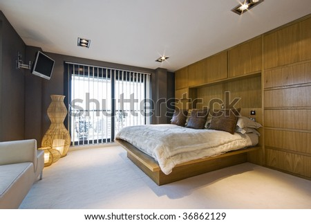 stunning luxury bedroom with a king size bed wall mount plasma tv