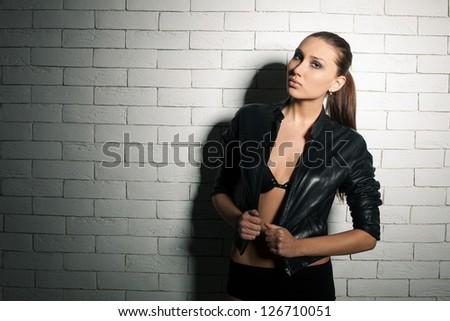 Stunning model posing in a studio, close up shot