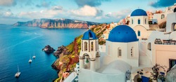 Stunning morning panorama of Santorini island. Splendid spring sunrise on famous Greek resort Oia, Greece, Europe. Traveling concept background. Artistic style post processed photo.