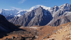 Stunning mountain panorama with snow-capped mountains viewed from the western ascent route of Renjo La pass in Sagarmatha National Park, Himalayas, Nepal on Three Passes Trek.