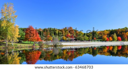 Stunning New England lake in fall with blue sky