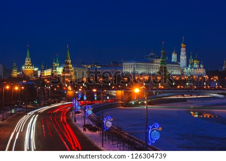 Stunning night view of Kremlin in the winter with car traces, Moscow, Russia