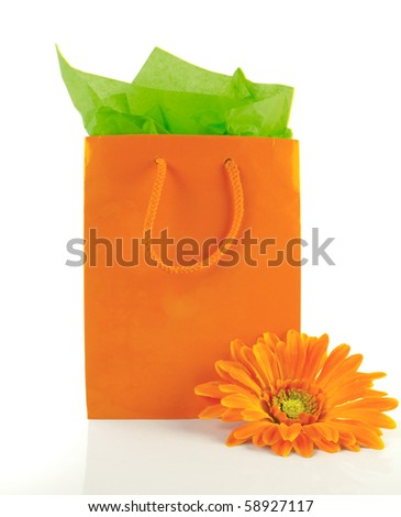 Stunning orange gift bag with matching tissue and flower
