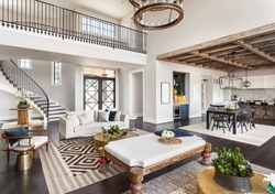 Stunning Panorama of Luxury Home Interior with Open Concept Floor Plan: Shows Living Room, Dining Room, Kitchen, and Entry. Elegant Stairs Lead up to Second Story.