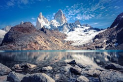 Stunning panoramic view from the lagoon of Los Tres towards Mount Fitz Roy and Cerro Torre in Los Glaciares National Park near El Chalten, Argentina