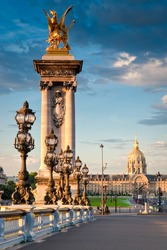 Stunning Pont Alexandre III bridge (1896) spanning the river Seine. Decorated with ornate Art Nouveau lamps and sculptures it is the most extravagant bridge in Paris.