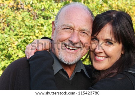 Stunning portrait of a senior father and his daughter