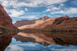 Stunning red rock reflection on the Colorado river near Glen Canyon recreation area and Lees Ferry in Arizona.