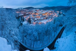Stunning scenic view of beautiful cityscape of medieval Loket nad Ohri town with Loket Castle gothic style on massive rock, colorful buildings during winter season, Karlovy Vary Region, Czech Republic