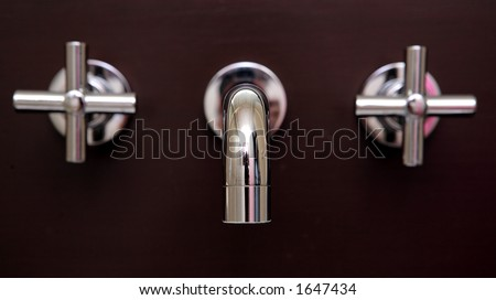 Stunning, shiny brand new chrome taps in villa bathroom