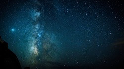 Stunning star-scape night sky shot with the milky way, bright stars, and multiple meteors during the Perseid meteor shower in the desert of Five Mile Pass in Utah