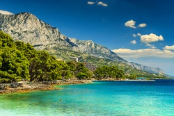 Stunning summer landscape with Adriatic Sea,Biokovo mountains and wonderful bay,Brela beach,Makarska riviera,Dalmatia,Croatia,Europe