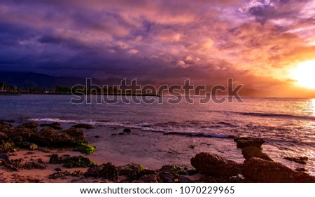 Stunning sunset at Haleiwa Beach Park, best beach to learn to surf , a gorgeous beach has lots of shade and free parking, rocky and shallow,picnic table,rest room,children's playground equipment.