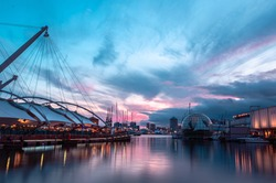 Stunning sunset in the ancient harbour of Genoa