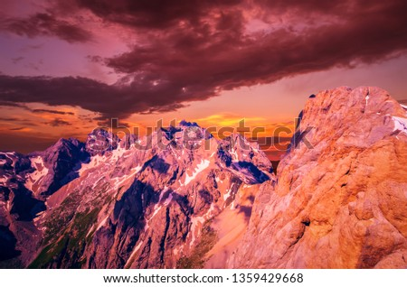 Stunning sunset over Marmolada massif, Dolomiti, Itay. Spectacular view over the Punta Rocca and other peaks in Dolomites mountains #1359429668