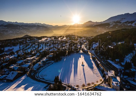 Stunning sunset over the Crans Montana village, above the Rhone valley, in Valais, Switzerland on a sunny winter evening. Photo stock ©