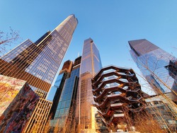 Stunning sunset photograph of the iconic Hudson Yards skyscrapers including The Vessel, located in Manhattan, New York