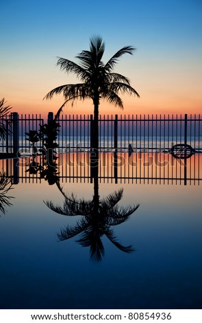 Stunning sunset with a reflection in infinity pool