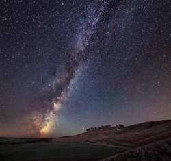 Stunning vibrant Milky Way composite image over landscape of ancient chalk white horse at Cherhill in Wiltshire