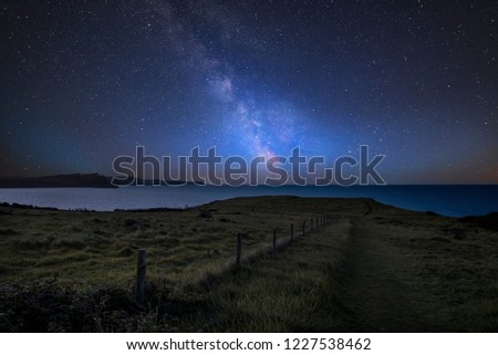 Stock Photo Stunning vibrant Milky Way composite image over landscape of Mupe Bay on Jurassic Coast in England